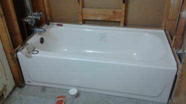 It's the bathtub installed, and I helped!