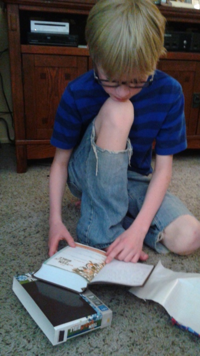 We chose a Teen Study Bible for him. He loves it...