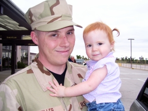 The day he deployed, saying 'bye to Little Red.